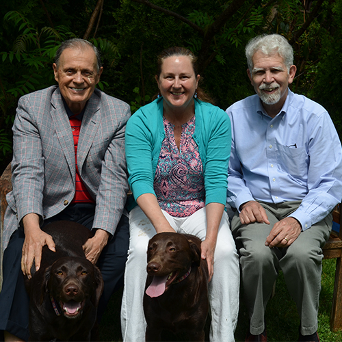 Eddie Woodin, Nancy Robinson, Larry Gross, with dogs Millie and Moxie.