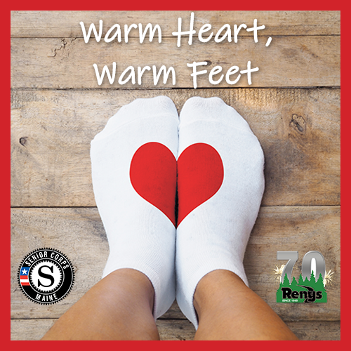white socks with a red heart design with text that reads warm heart, warm feet
