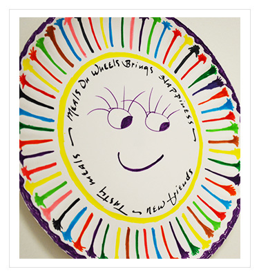 smiling face drawn on a paper plate