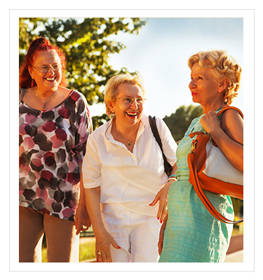 group of three older women smiling