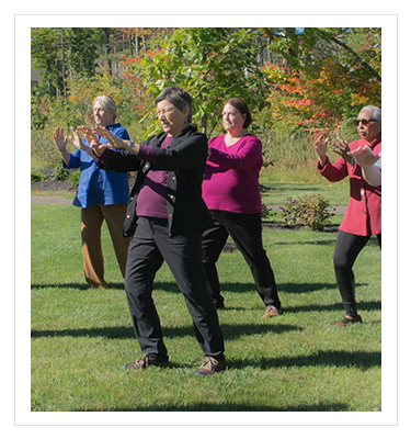 man and woman doing tai chi
