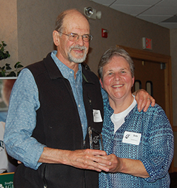 david vail receiving hall of fame award from deb smith